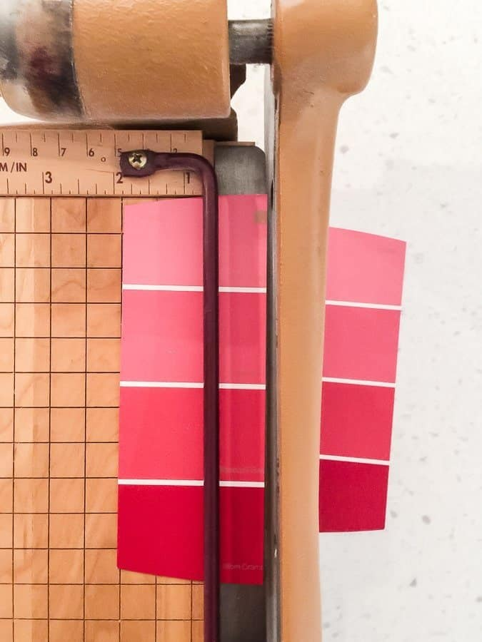 Cut the paint chip in half to create your DIY Bookmarks.