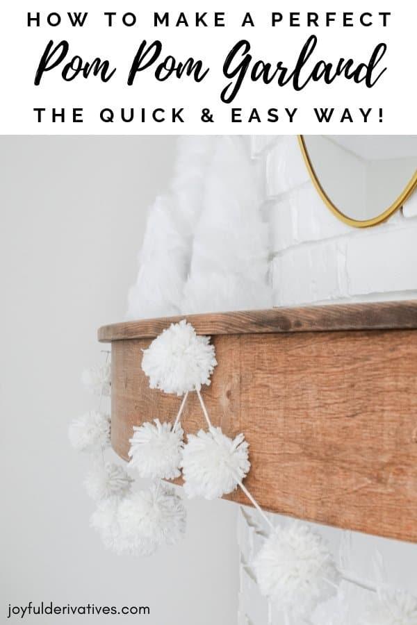 """Close up of white pom pom garland with text overlay """"how to make a perfect pom pom garland"""""""