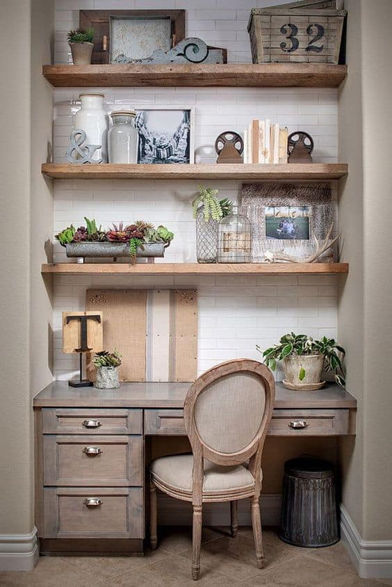 Farmhouse style desk nook with floating shelves above the desk.