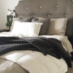 Bed Dressed for a Modern Farmhouse Master Bedroom Tour