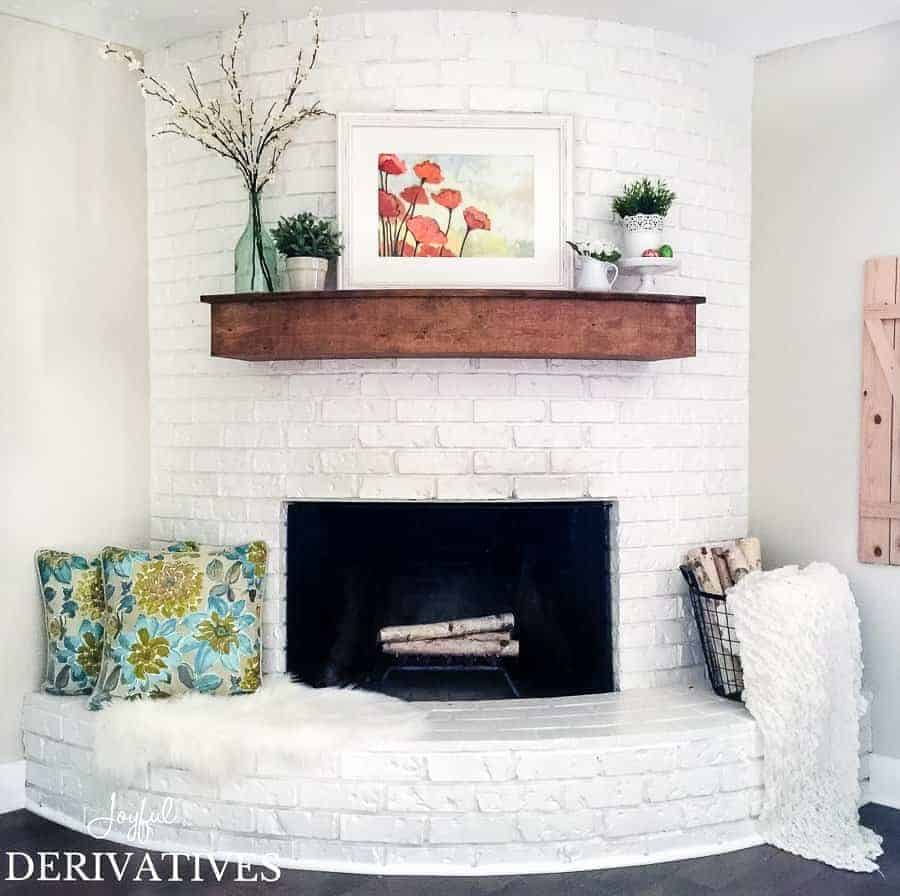 Farmhouse fireplace with spring mantel ideas.