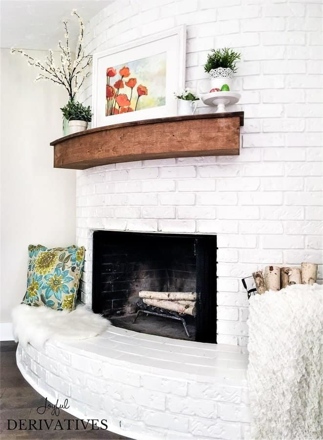 White fireplace with floating mantel showing spring mantel ideas.