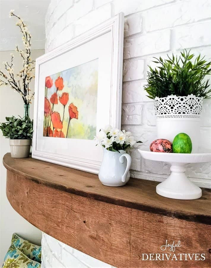 Spring mantel ideas on a wood floating mantel.