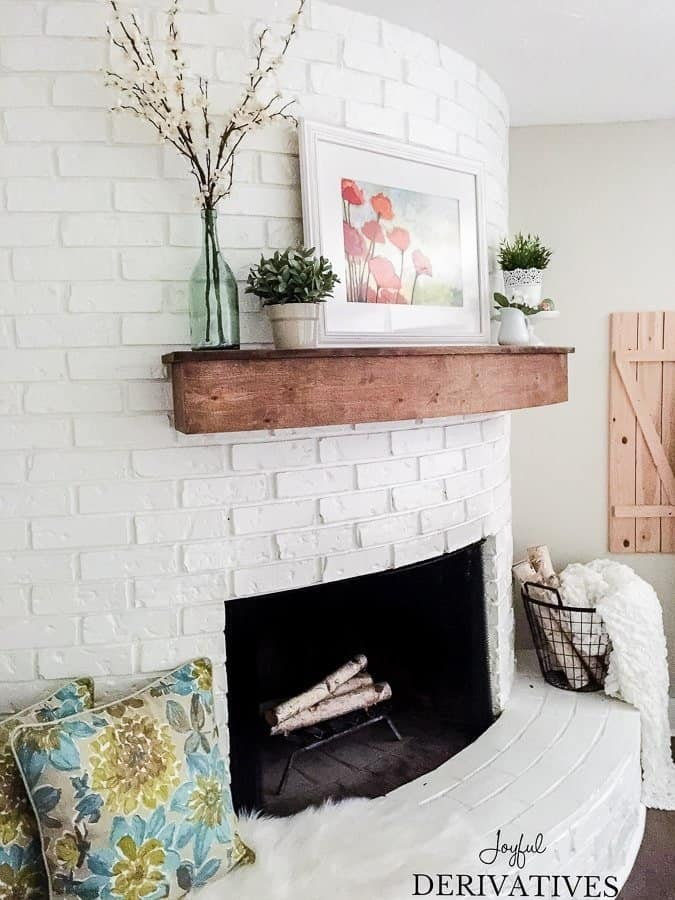 Spring mantel ideas for a white fireplace with wood mantel.