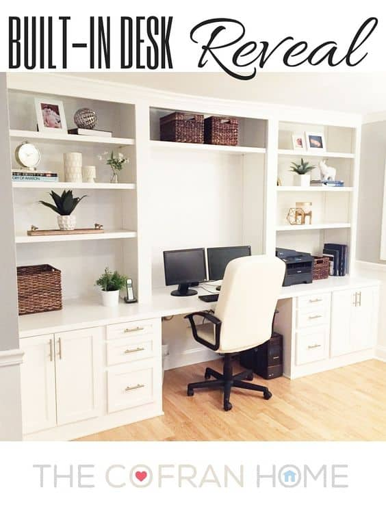 Built-in desk with white open shelves above.