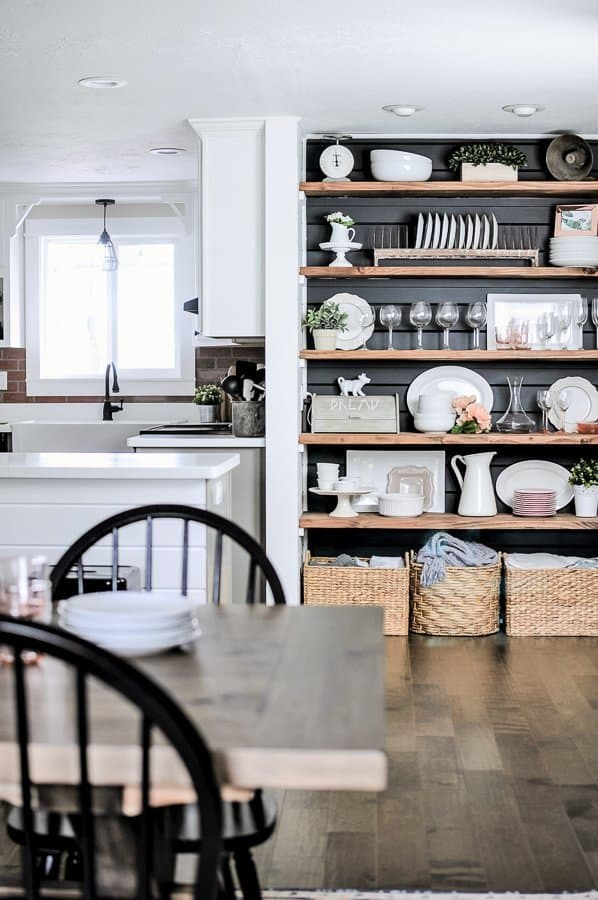Farmhouse kitchen with built in hutch and bread box hiding a charging station diy.
