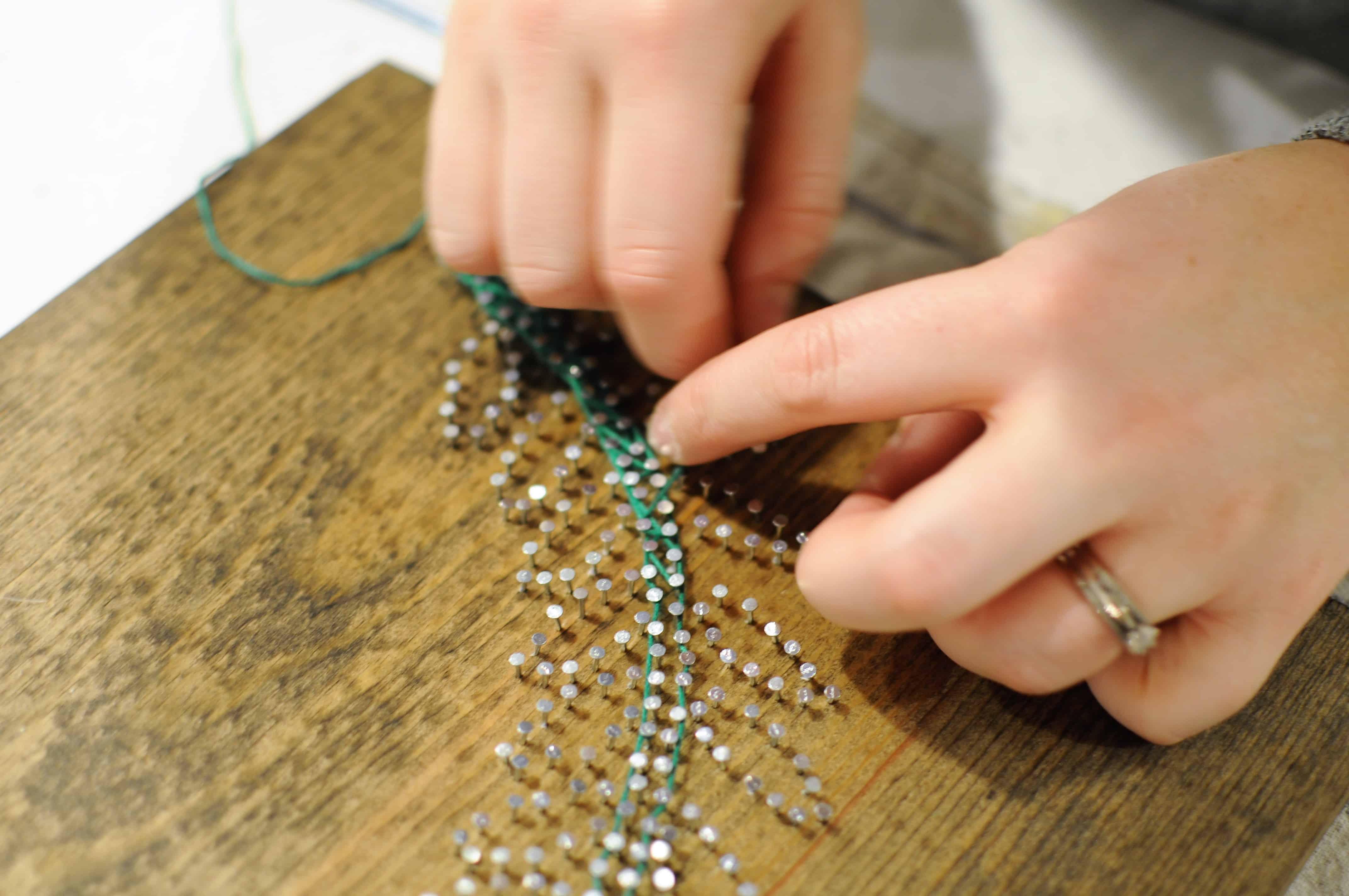 diy string art stringing between nails