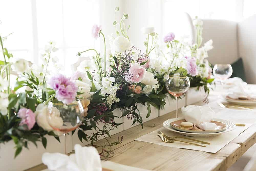 One of 5 easter tablescapes - this one has large floral bouquet runner and blush glasses.