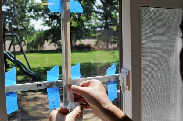When you install a window grid, use white electrical tape on the inner panes of each side.