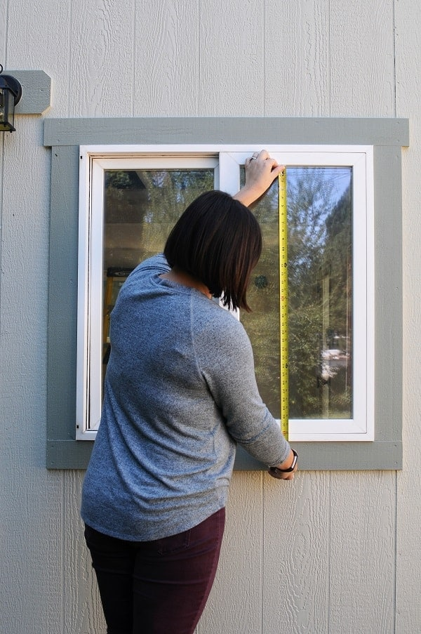 Measure the height of your window pane so you can cut the right length of trim to install a window grid.