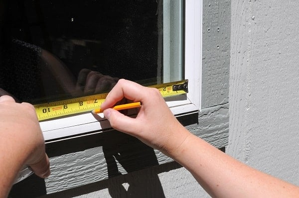 Use a pencil to note where the trim goes when you install a window trim.