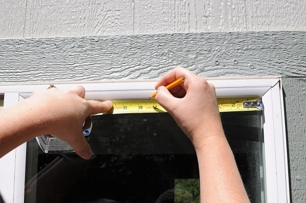 Mark the upper location of your trim to install a window grid.
