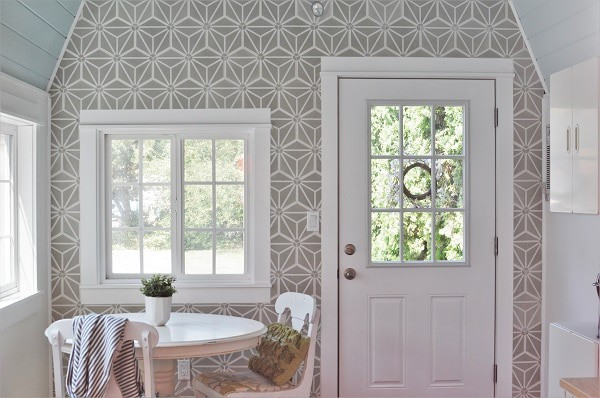 Cement tile accent wall in she shed home office.