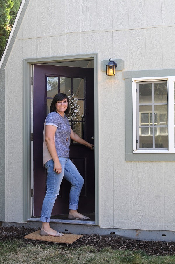Rachel stepping into the she shed home office.