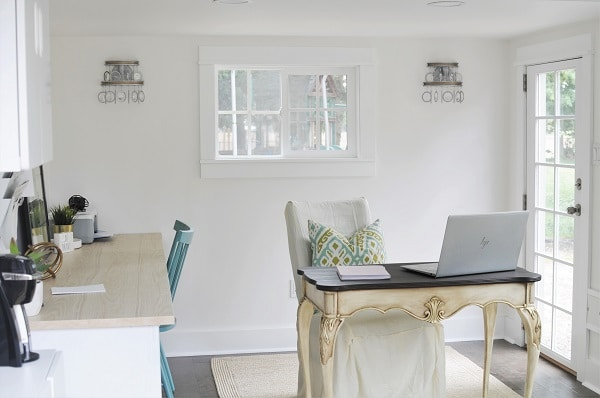 Crystal wall sconces as statement light fixtures in a home office.