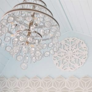 Statement light fixtures like a crystal chandelier.