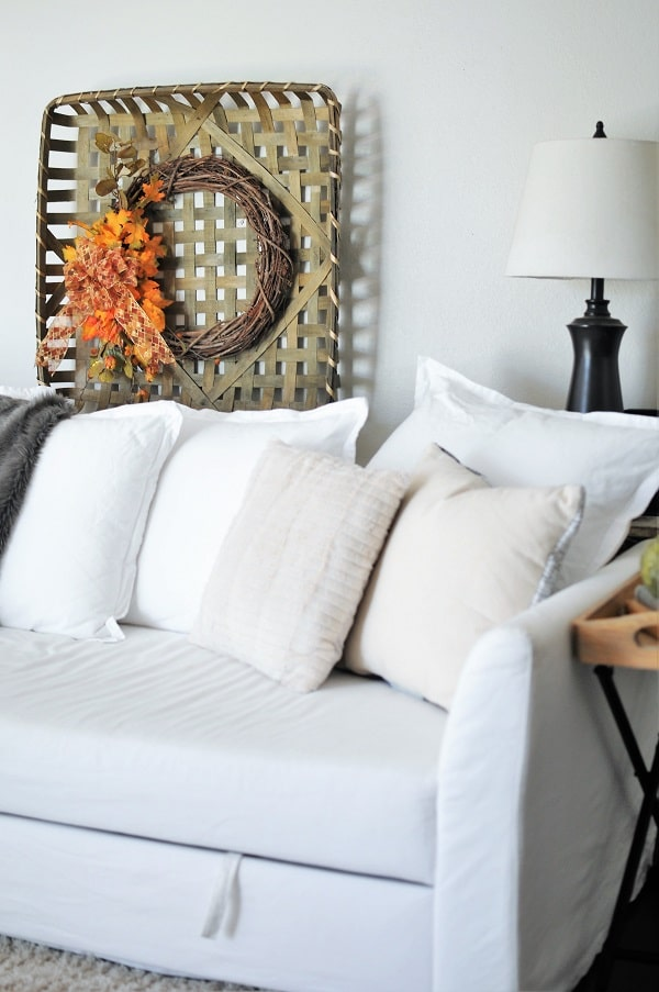 Living room decorated for fall with neutral fall decor.