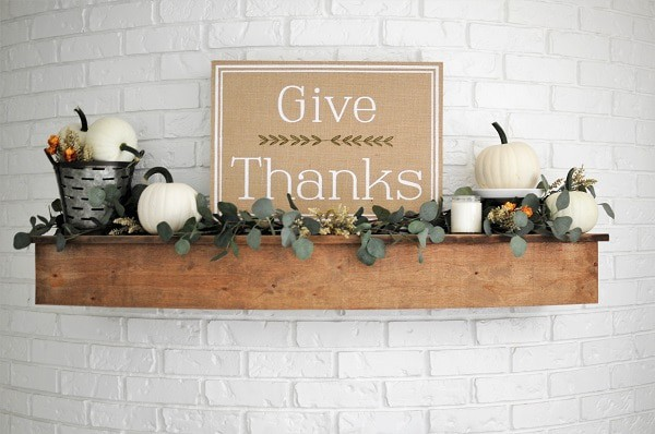 "Fall mantel with ""Give Thanks"" sign and neutral fall decor."