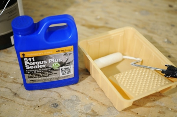 Tile accent wall sealer with roller and tray for application.