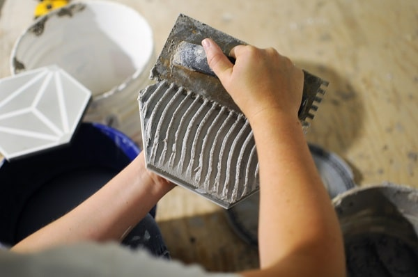 Scrape the mortar with your notched edge for the tile accent wall installation.