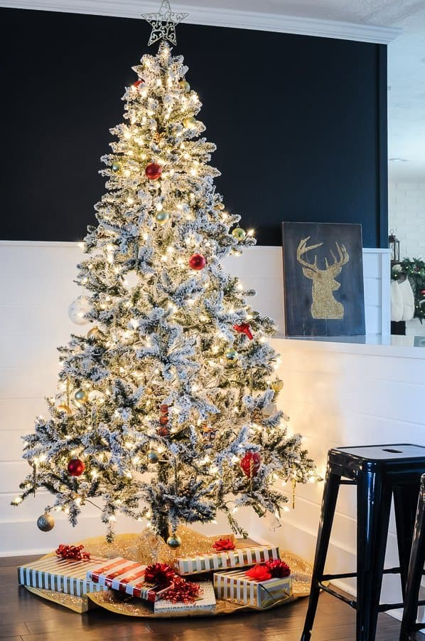 Flocked tree in a traditional holiday home tour.