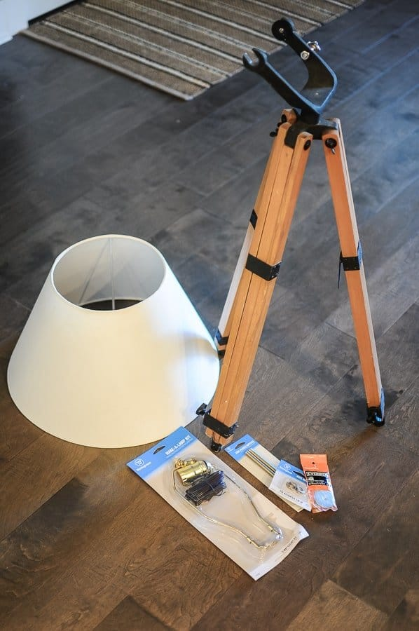 Materials needed to make a DIY floor lamp out of a tripod.