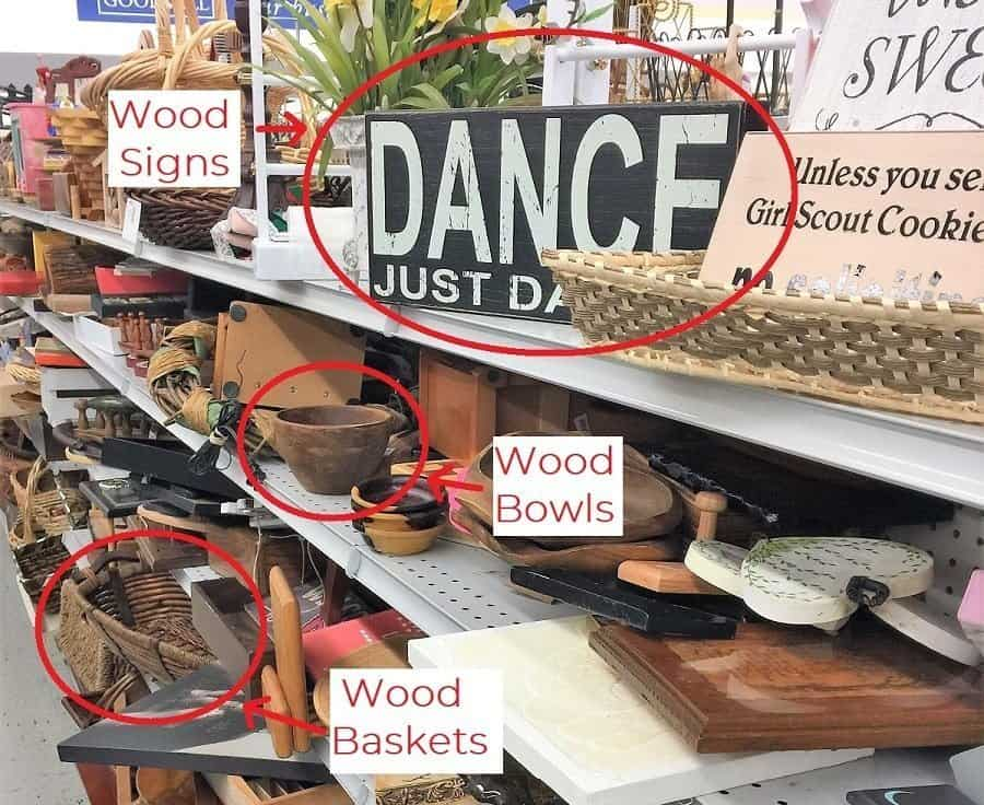 Close up of wooden items on thrift store shelves with sign, bowls and baskets worth purchasing circled in red.