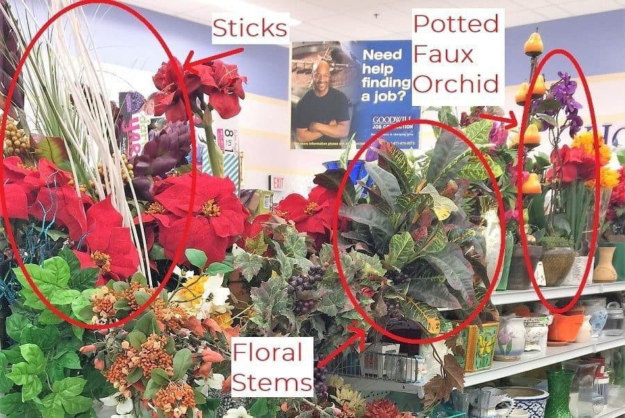 Close up of artificial plants on a thrift store shelf with red circles around items worth getting,.