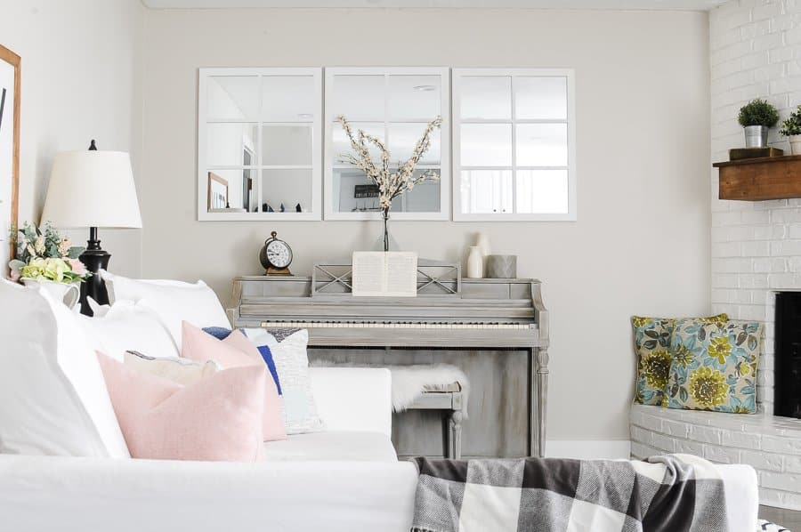 White couch and grey piano in spring living room tour.