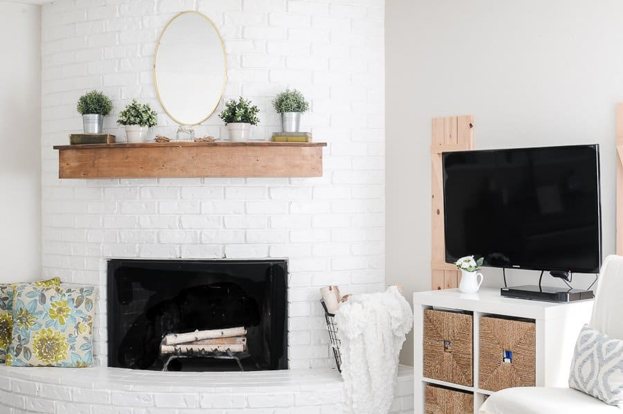 White fireplace and mounted tv in spring living room.