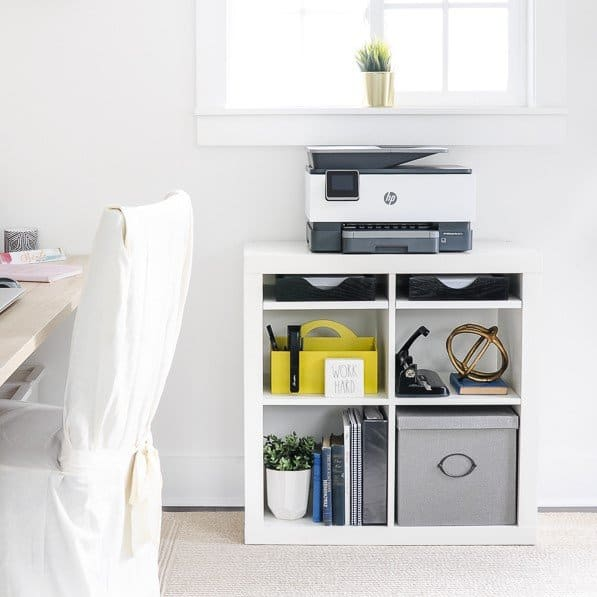 Home office setup ideas for a making a printer station out of a white bookcase.