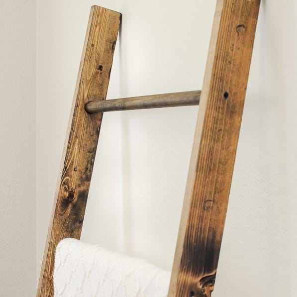 Close up view of DIY blanket ladder from tutorial on how to make a blanket ladder.