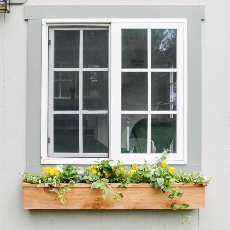 How to build an easy diy window box for cheap! Adding a simple cedar window planter box to your home can add fun style and excellent curb appeal. Learn to build one for under $15 in a few hours! #diy #windowbox