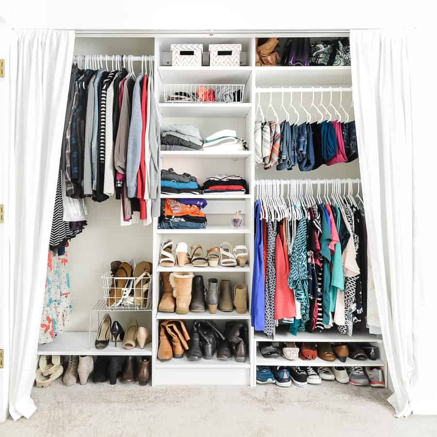 Wide angle view of an organized closet as an example for how to declutter your closet.