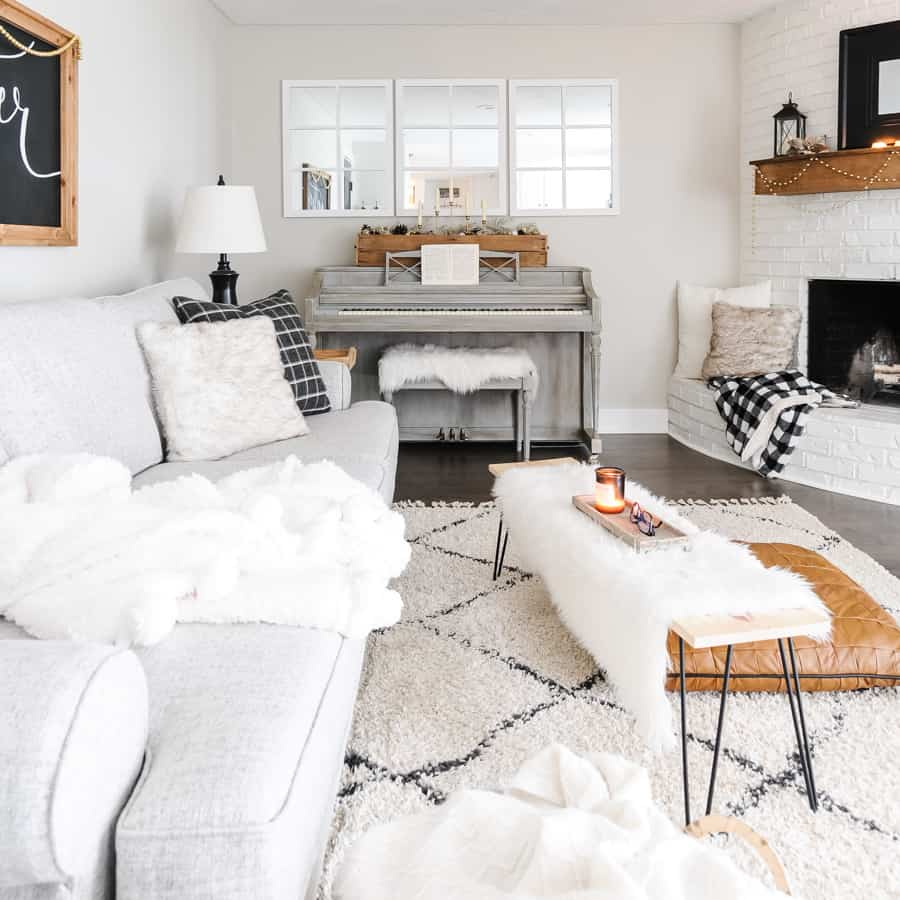 Sofa, coffee table and piano decorated with simple, winter decor.